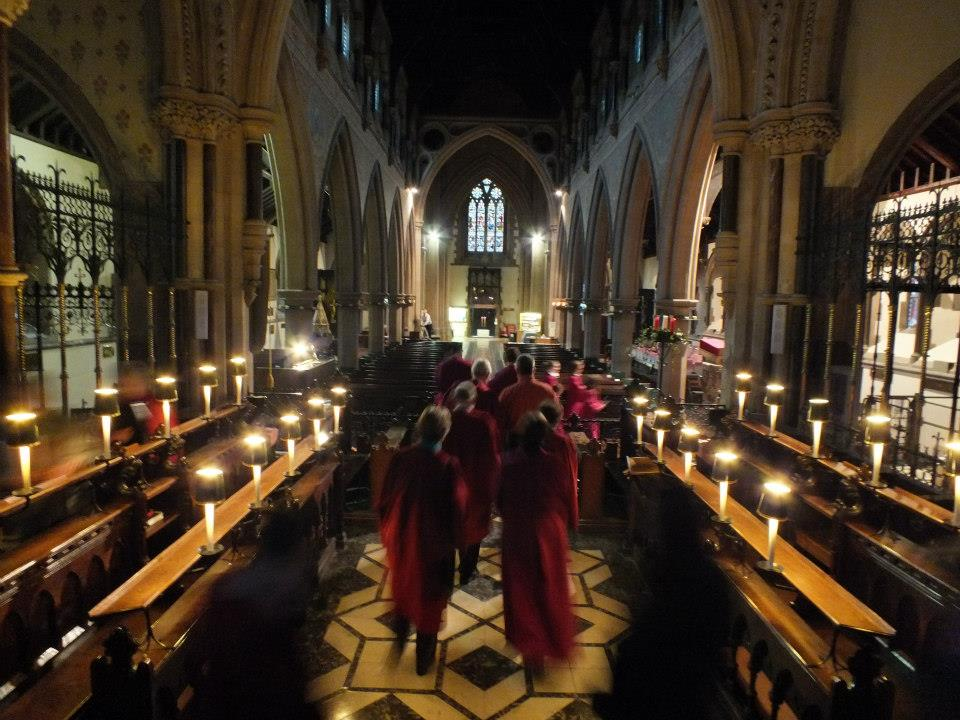 The choir in the beautifully lit church at Christmas