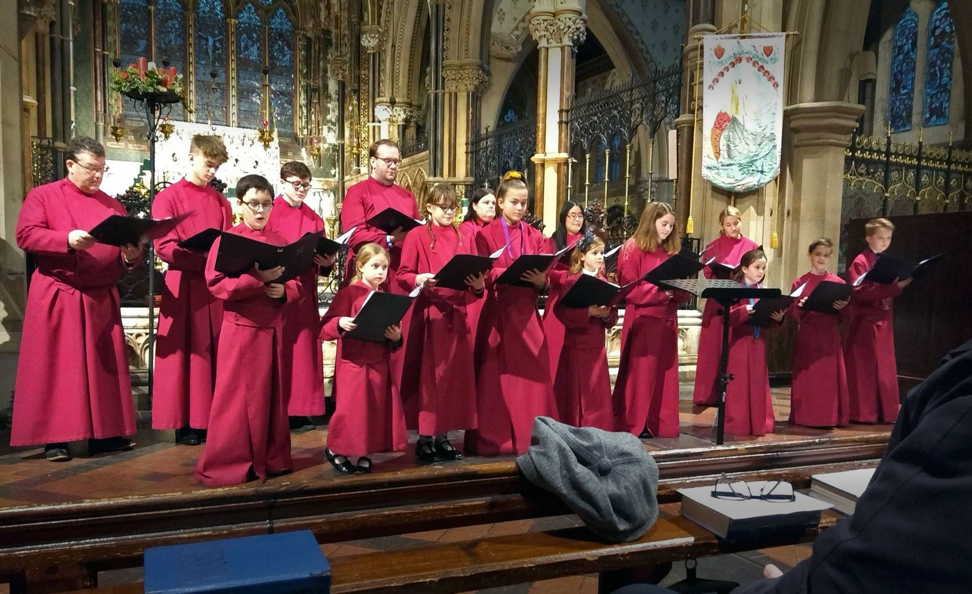 The choir singing for a concert in the church at Christmas